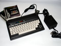 The Commodore +4 with manual and power supply.