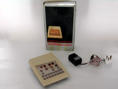 The Commodore Chessmate with original packaging and power supply.