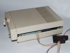 A modified Commodore 1541-II disk drive with a speed loader system.