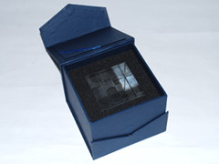 A box with a glass cube to honor 25 years of Commodore.